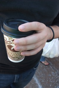 Eddie holding a cup of coffee